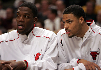 CHICAGO - NOVEMBER 9:  Eddy Curry #2 (L) and Tyson Chandler #3 of the Chicago Bulls watch the end of a game against the Phoenix Suns from the bench on November 9, 2004 at the United Center in Chicago, Illinois. The Suns defeated the Bulls 94-74. NOTE TO U
