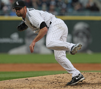 CHICAGO, IL - MAY 17: Starting pitcher John Danks #50 of the Chicago White Sox follows through after throwing a pitch against the Texas Rangers at U.S. Cellular Field on May 17, 2011 in Chicago, Illinois. (Photo by Jonathan Daniel/Getty Images)
