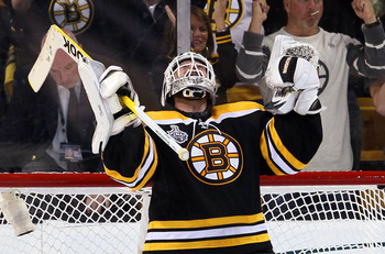 BOSTON, MA - JUNE 06:  Tim Thomas #30 of the Boston Bruins celebrates after defeating the Vancouver Canucks in Game Three of the 2011 NHL Stanley Cup Final at TD Garden on June 6, 2011 in Boston, Massachusetts. The Boston Bruins defeated the Vancouver Can