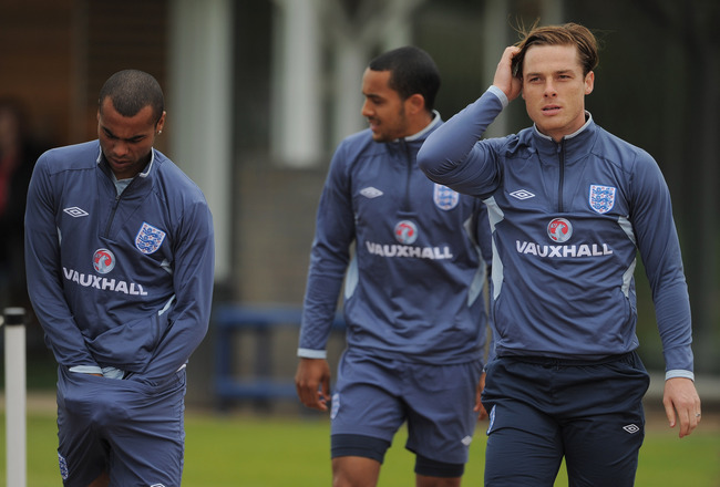 ST ALBANS, ENGLAND - MAY 31: Ashley Cole, Theo Walcott and Scott Parker look on during the England training session at London Colney on May 31, 2011 in St Albans, England.  (Photo by Michael Regan/Getty Images)