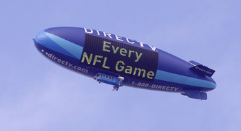 HOUSTON - NOVEMBER 28:  The DIrecTV blimp flies over Reliant Stadium on November 28, 2010 in Houston, Texas.  (Photo by Bob Levey/Getty Images)