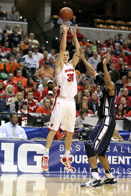 INDIANAPOLIS, IN - MARCH 11:  Jon Leuer #30 of the Wisconsin Badgers attempts a shot against the Penn State Nittany Lions during the quarterfinals of the 2011 Big Ten Men's Basketball Tournament at Conseco Fieldhouse on March 11, 2011 in Indianapolis, Ind