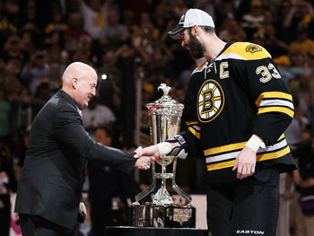 BOSTON, MA - MAY 27:  Deputy Commissioner Bill Daly shakes the hand of Zdeno Chara #33 of the Boston Bruins as he presents the The Prince of Wales trophy after they defeated the Tampa Bay Lightning 1 to 0 in Game Seven of the Eastern Conference Finals dur