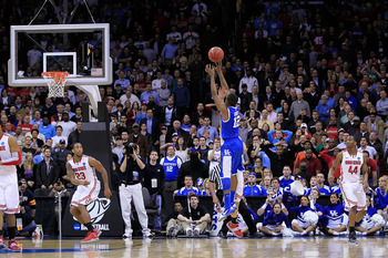 NEWARK, NJ - MARCH 25:  Brandon Knight #12 of the Kentucky Wildcats shoots the winning shot to defeat the Ohio State Buckeyes in the east regional semifinal of the 2011 NCAA Men's Basketball Tournament at the Prudential Center on March 25, 2011 in Newark,
