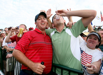 LOUISVILLE, KY - SEPTEMBER 21:  Boo Weekley of the USA team celebrates with a fan after his 4 & 2 victory during the singles matches on the final day of the 2008 Ryder Cup at Valhalla Golf Club on September 21, 2008 in Louisville, Kentucky.  (Photo by And