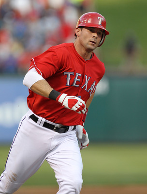 ARLINGTON, TX - MAY 07:  Michael Young #10 of the Texas Rangers hits a solo homerun against the New York Yankees at Rangers Ballpark in Arlington on May 7, 2011 in Arlington, Texas.  (Photo by Ronald Martinez/Getty Images)