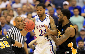 SAN ANTONIO, TX - MARCH 27:  Markieff Morris #21 of the Kansas Jayhawks handles the ball against Jamie Skeen #21 of the Virginia Commonwealth Rams during the southwest regional final of the 2011 NCAA men's basketball tournament at the Alamodome on March 2