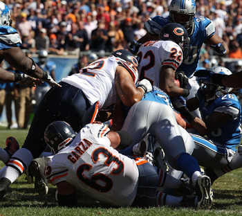 CHICAGO - SEPTEMBER 12: Matt Forte #22 of the Chicago Bears is stopped short of the goal line on a 4th down play against the Detroit Lions during the NFL season opening game at Soldier Field on September 12, 2010 in Chicago, Illinois. The Bears defeated t