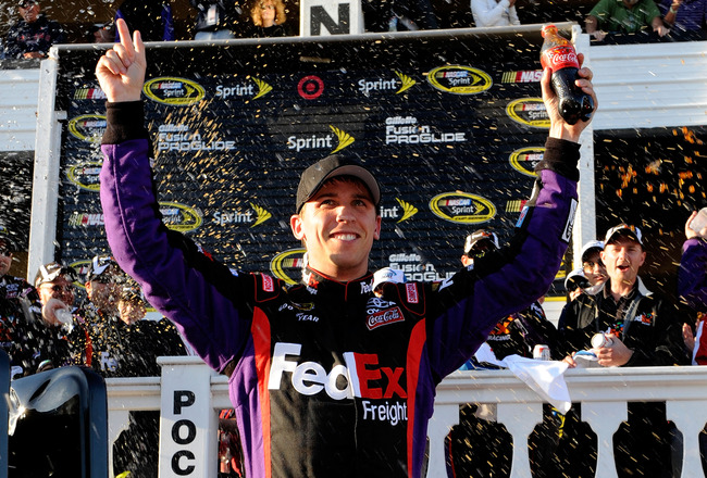 LONG POND, PA - JUNE 06:  Denny Hamlin, driver of the #11 FedEx Freight Toyota, celebrates in victory lane after winning the NASCAR Sprint Cup Series Gillette Fusion ProGlide 500 at Pocono Raceway on June 6, 2010 in Long Pond, Pennsylvania.  (Photo by Joh