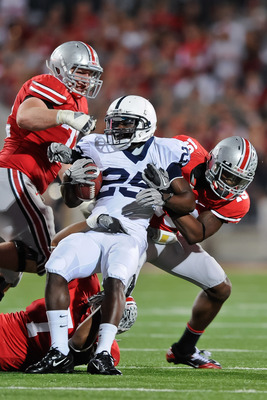 COLUMBUS, OH - NOVEMBER 13:  Silas Redd #25 of the Penn State Nittany LIons is tackled by Jermale Hines #7, Orhian Johnson #19 and Dexter Larimore #72, all of the Ohio State Buckeyes at Ohio Stadium on November 13, 2010 in Columbus, Ohio.  (Photo by Jamie
