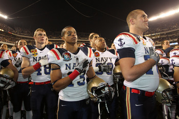 PHILADELPHIA - DECEMBER 11: Safety Jordan Fraser #13 of the Navy Midshipmen listens to the Navel Academy's alma mater with teammates after a game against the Army Black Knights on December 11, 2010 at Lincoln Financial Field in Philadelphia, Pennsylvania.