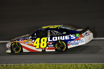 CONCORD, NC - MAY 29:  Jimmie Johnson drives the #48 Lowe's Summer Salute Chevrolet on the aprin after an incident in the NASCAR Sprint Cup Series Coca-Cola 600 at Charlotte Motor Speedway on May 29, 2011 in Concord, North Carolina.  (Photo by John Harrel