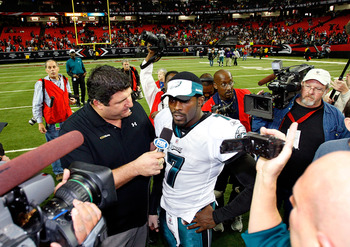 ATLANTA - DECEMBER 06:  Michael Vick #7 of the Philadelphia Eagles is interviewed by Fox Network sideline reporter Tony Siragusa (L) after their 34-7 win over the Atlanta Falcons at Georgia Dome on December 6, 2009 in Atlanta, Georgia.  (Photo by Kevin C.