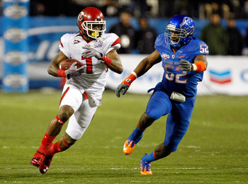 LAS VEGAS, NV - DECEMBER 22:  Shaky Smithson #1 of the Utah Utes runs for yardage against Derrell Acrey #52 of the Boise State Broncos during the MAACO Bowl Las Vegas at Sam Boyd Stadium December 22, 2010 in Las Vegas, Nevada. Boise State Won 26-3.  (Phot