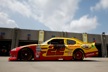 CHARLOTTE, NC - MAY 28:  (***EDITORS NOTE*** - THIS DIGITAL IMAGE WAS CREATED WITH THE USE OF VARIABLE FOCAL PLANE LENS) Kurt Busch drives the #22 Shell/Pennzoil Dodge through the garage area during practice for the NASCAR Sprint Cup Series Coca-Cola 600