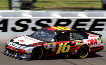 KANSAS CITY, KS - JUNE 05:  Greg Biffle, driver of the #16 3M/Walgreens Ford, races during the NASCAR Sprint Cup Series STP 400 at Kansas Speedway on June 5, 2011 in Kansas City, Kansas.  (Photo by Jerry Markland/Getty Images for NASCAR)