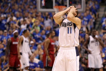 DALLAS, TX - JUNE 05:  Jose Juan Barea #11 of the Dallas Mavericks reacts while taking on the Miami Heat in the second half of Game Three of the 2011 NBA Finals at American Airlines Center on June 5, 2011 in Dallas, Texas.  NOTE TO USER: User expressly ac
