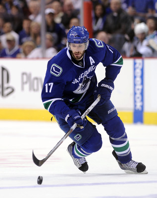 VANCOUVER, CANADA - MAY 18:  Ryan Kesler #17 of the Vancouver Canucks skates the puck across the blue line in Game Two of the Western Conference Finals against the San Jose Sharks during the 2011 Stanley Cup Playoffs at Rogers Arena on May 18, 2011 in Van