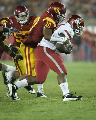 LOS ANGELES, CA - SEPTEMBER 26:  Linebacker Jarvis Jones #10 of the USC Trojans tackles running back Logwone Mitz #34 of the Washington State Cougars on September 23, 2009 at the Los Angeles Coliseum in Los Angeles, California.  USC won 27-6.  (Photo by S