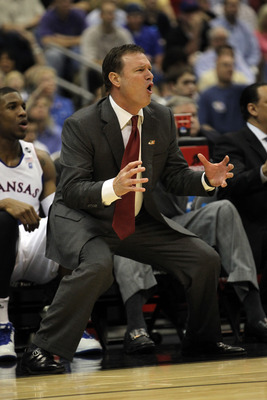 SAN ANTONIO, TX - MARCH 25:  Head coach Bill Self of the Kansas Jayhawks reacts during the southwest regional of the 2011 NCAA men's basketball tournament against the Richmond Spiders at the Alamodome on March 25, 2011 in San Antonio, Texas. Kansas defeat