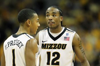 COLUMBIA, MO - JANUARY 17:  Marcus Denmon #12 of the Missouri Tigers talks with Phil Pressey #1 during a timeout in the game against the Kansas State Wildcats on January 17, 2011 at Mizzou Arena in Columbia, Missouri.  (Photo by Jamie Squire/Getty Images)
