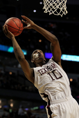 CHICAGO, IL - MARCH 18:  David Loubeau #10 of the Texas A&M Aggies shoots against the Florida State Seminoles in the second half during the second round of the 2011 NCAA men's basketball tournament at the United Center on March 18, 2011 in Chicago, Illino