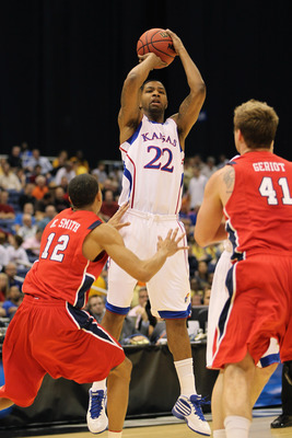 SAN ANTONIO, TX - MARCH 25:  Marcus Morris #22 of the Kansas Jayhawks shoots over Kevin Smith #12 and Dan Geriot #41 of the Richmond Spiders during the southwest regional of the 2011 NCAA men's basketball tournament at the Alamodome on March 25, 2011 in S