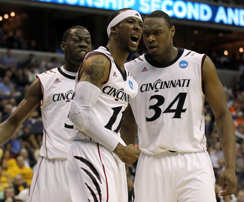 WASHINGTON - MARCH 17:  Larry Davis #11 of the Cincinnati Bearcats celebrates a dunk with teammates Yancy Gates #34 and Justin Jackson #5 against the Missouri Tigers during the second round of the 2011 NCAA men's basketball tournament at the Verizon Cente