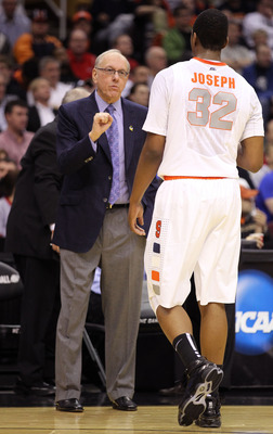 CLEVELAND, OH - MARCH 18: Head coach Jim Boeheim of the Syracuse Orange speaks to Kris Joseph #32 of the Syracuse Orange during the game against the Indiana State Sycamores during the second round of the 2011 NCAA men's basketball tournament at Quicken Lo