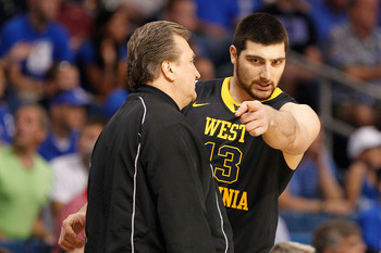 TAMPA, FL - MARCH 19:  (L-R) Head coach Bob Huggins of the West Virginia talks with Deniz Kilicli #13 against the Kentucky Wildcats during the third round of the 2011 NCAA men's basketball tournament at St. Pete Times Forum on March 19, 2011 in Tampa, Flo