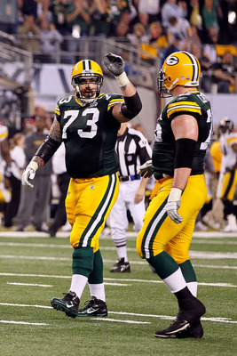 ARLINGTON, TX - FEBRUARY 06:  Daryn Colledge #73 of the Green Bay Packers reacts against the Pittsburgh Steelers during Super Bowl XLV at Cowboys Stadium on February 6, 2011 in Arlington, Texas.  (Photo by Kevin C. Cox/Getty Images)