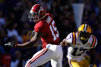 BATON ROUGE, LA - NOVEMBER 06:  Darius Hanks #15 of the Alabama Crimson Tide avoids a tackle by Morris Claiborne #17 of the Louisiana State University Tigers at Tiger Stadium on November 6, 2010 in Baton Rouge, Louisiana.  (Photo by Chris Graythen/Getty I