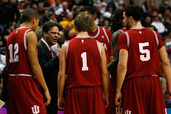 INDIANAPOLIS, IN - MARCH 10:  Head coach Tom Crean of the Indiana Hoosiers talks with his players during a timeout against the Penn State Nittany Lions during the first round of the 2011 Big Ten Men's Basketball Tournament at Conseco Fieldhouse on March 1