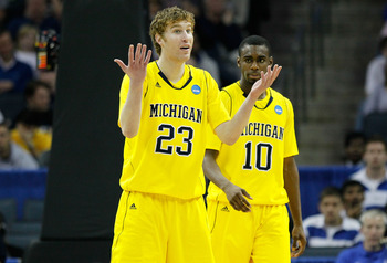 CHARLOTTE, NC - MARCH 20:  Evan Smotrycz #23 and Tim Hardaway Jr. #10 of the Michigan Wolverines react while taking on the Duke Blue Devils during the third round of the 2011 NCAA men's basketball tournament at Time Warner Cable Arena on March 20, 2011 in