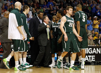 TAMPA, FL - MARCH 17:  Head coach Tom Izzo of the Michigan State Spartans address his players during a timeout in the second half against the UCLA Bruins during the second round of the 2011 NCAA men's basketball tournament at St. Pete Times Forum on March