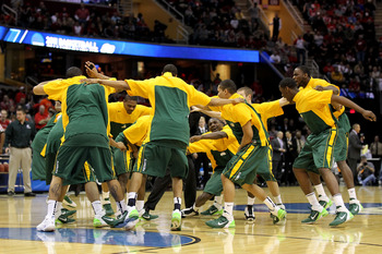 CLEVELAND, OH - MARCH 20: The George Mason Patriots huddle before their game against the Ohio State Buckeyes during the third of the 2011 NCAA men's basketball tournament at Quicken Loans Arena on March 20, 2011 in Cleveland, Ohio.  (Photo by Andy Lyons/G