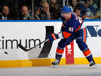 UNIONDALE, NY - MARCH 24:  John Tavares #91 of the New York Islanders skates during an NHL hockey game against the Atlanta Thrashers at the Nassau Coliseum on March 24, 2011 in Uniondale, New York.  (Photo by Paul Bereswill/Getty Images)