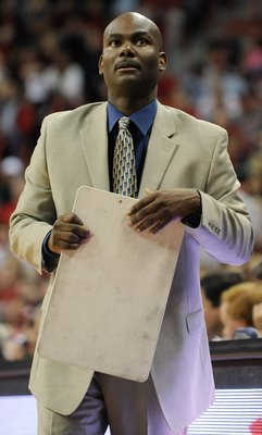 LAS VEGAS - NOVEMBER 18:  Head coach David Carter of the Nevada Wolf Pack checks the scoreboard during a game against the UNLV Rebels at the Thomas & Mack Center on November 18, 2009 in Las Vegas, Nevada. UNLV won 88-75.  (Photo by Ethan Miller/Getty Imag