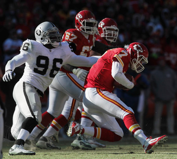 KANSAS CITY, MO - JANUARY 02:  Quarterback Matt Cassel #7 of the Kansas City Chiefs is sacked by Kamerion Wimbley #96 of the Oakland Raiders during the game on January 2, 2011 at Arrowhead Stadium in Kansas City, Missouri.  (Photo by Jamie Squire/Getty Im