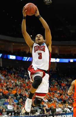 TULSA, OK - MARCH 18:  Anthony Marshall #3 of the UNLV Rebels goes up for a shot against the Illinois Fighting Illini during the second round of the 2011 NCAA men's basketball tournament at BOK Center on March 18, 2011 in Tulsa, Oklahoma.  (Photo by Tom P