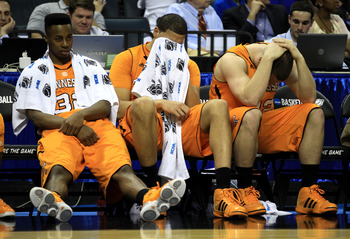 CHARLOTTE, NC - MARCH 18:  (L-R) Scotty Hopson #32, Brian Williams #33 and Steven Pearl #22 of the Tennessee Volunteers sit on the bench late in the second half before losing to the Michigan Wolverines 75-45 during the second round of the 2011 NCAA men's