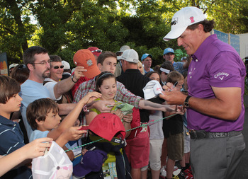 CHARLOTTE, NC - MAY 05:  Phil Mickelson signs autographs for fans during the first round of the Wells Fargo Championship at the Quail Hollow Club on May 5, 2011 in Charlotte, North Carolina.  (Photo by Scott Halleran/Getty Images)