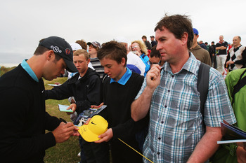SOUTHPORT, UNITED KINGDOM - JULY 15:  Paul Casey of England signs autographs for fans during the second practice round of the 137th Open Championship on July 15, 2008 at Royal Birkdale Golf Club, Southport, England.  (Photo by Stuart Franklin/Getty Images