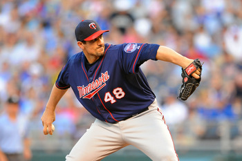 KANSAS CITY, MO - JUNE 3:  Starter Carl Pavano #48 of the Minnesota Twins pitches against the Kansas City Royals at Kauffman Stadium on June 3, 2011 in Kansas City, Missouri. (Photo by G. Newman Lowrance/Getty Images)