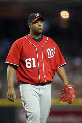 PHOENIX, AZ - JUNE 04:  Starting pitcher Livan Hernandez #61 of the Washington Nationals during the Major League Baseball game against the Arizona Diamondbacks at Chase Field on June 4, 2011 in Phoenix, Arizona.  The Diamondbacks defeated the Nationals 2-