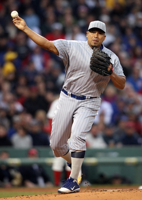 BOSTON, MA - MAY 21:  Carlos Zambrano #38 of the Chicago Cubs sends the ball back to first base in the first inning against the Boston Red Sox on May 21, 2011 at Fenway Park in Boston, Massachusetts. Tonight the Chicago Cubs and the Boston Red Sox are wea
