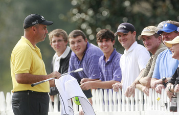 MADISON, MS - OCTOBER 29:  Rocco Mediate talks with fans after first round play was postponed in the Viking Classic at the Annandale Golf Club on October 29, 2009 in  Madison, Mississippi.  (Photo by Dave Martin/Getty Images)