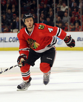 CHICAGO, IL - MARCH 23: Niklas Hjalmarsson #4 of the Chicago Blackhawks skates against the Florida Panthers at the United Center on March 23, 2011 in Chicago, Illinois. The Blackhawks defeated the Panthers 4-0.  (Photo by Bruce Bennett/Getty Images)