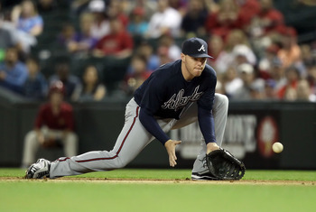 PHOENIX, AZ - MAY 18:  Infielder Freddie Freeman #5 of the Atlanta Braves fields a ground ball out against the Arizona Diamondbacks during the Major League Baseball game at Chase Field on May 18, 2011 in Phoenix, Arizona.  (Photo by Christian Petersen/Get