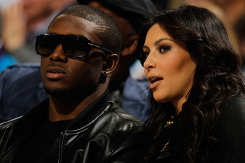 NEW ORLEANS - JANUARY 18:  New Orleans Saints player Reggie Bush sits with Kim Kardashian on the court during the game between the San Antonio Spurs and the New Orleans Hornets at New Orleans Arena on January 18, 2010 in New Orleans, Louisiana.   NOTE TO